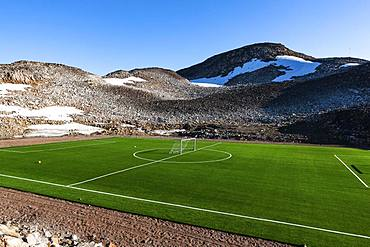 Football pitch with artificial turf, Ittoqqortoormiit, Scoresbysund, East Greenland, Greenland, North America