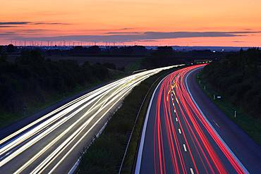Light tracks on the A14 motorway at dusk, near Halle an der Saale, Saxony-Anhalt, Germany, Europe