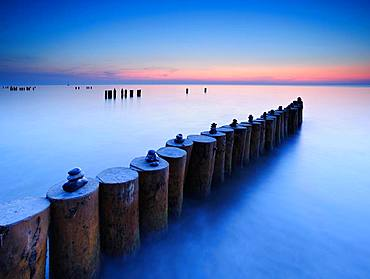 Sunset at the Baltic Sea, cairns on groyne, Weststrand, Fischland-Darss-Zingst, Mecklenburg-Western Pomerania, Germany, Europe