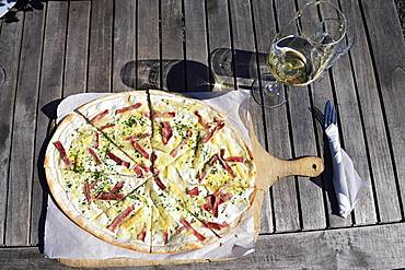Pfaelzer Flammkuchen with ham and paprika and a glass of white wine, German Wine Route, Rhineland-Palatinate, Germany, Europe