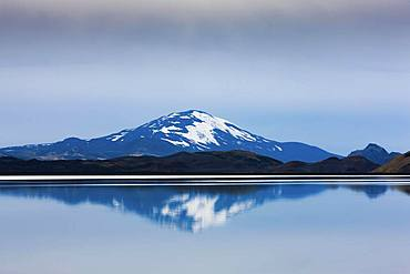 Reflection of the snow-covered volcanic cone Hekla in Hrauneyjalon, South Iceland, Iceland, Europe