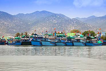 Vietnamese fishing boats in port near Cana, South China Sea, Vietnam, Asia