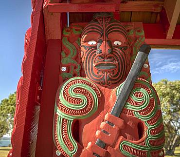 Traditionally carved and painted figure of Maori, Waitangi, Far North District, Northland, North Island, New Zealand, Oceania