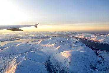 Aerial view, snow-covered mountains with fjord, province Tromsoe, Tromsoe, Norway, Europe