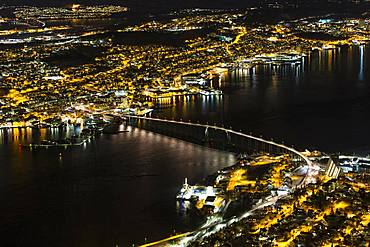 View from Fjellheisen to the Arctic Cathedral and the car bridge at night, Tromsoe, Norway, Europe
