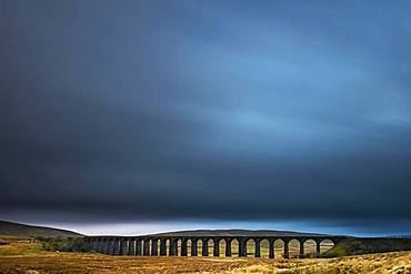Railway bridge, Ribblehead viaduct in autumn landscape with dramatic cloud sky, Ingelton, Yorkshire Dales National Park, Midlands, Great Britain