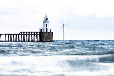 Lighthouse and windmill in the sea, Newcastle upon Tyne, Northumberland, Great Britain