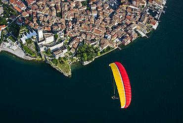 Paraglider over the old town and Castello di Malcesine, Malcesine at Lake Garda, aerial view, Province of Veneto, Italy, Europe