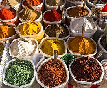 Spices, herbs and curry powders on display at Anjuna Beach Flea Market, Goa, India, Asia