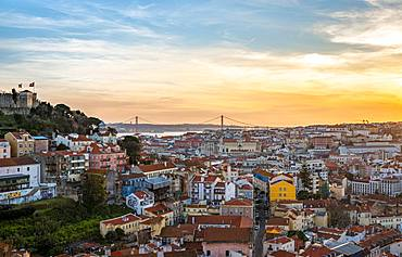 City view, view over Lisbon with Castelo de Sao Jorge and Ponte 25 de Abril at sunset, viewpoint Graca, Lisbon, Portugal, Europe