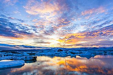 Icebergs in the glacier lagoon Joekulsarlon at sunset, South Iceland, Iceland, Europe