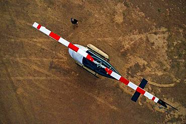 Aerial view, helicopter Bell Jet RANGER 206B for tourist flights on ground, at Wolwedans Dunes Lodge, NamibRand Nature Reserve, Namibia, Africa