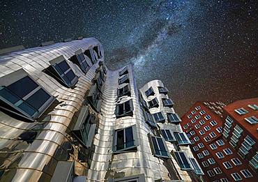 Gehry buildings at night, starry sky, Duesseldorf, Germany, Europe