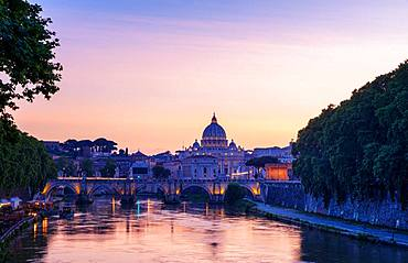 Saint Peter's Basilica with Sant' Angelo's Bridge over Tiber at sunset, Rome, Italy, Europe