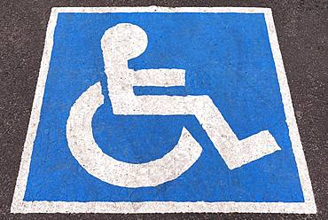 Blue marked parking place for disabled people, Romania, Europe