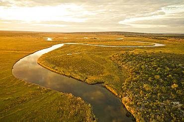 Aerial view, Cuanavale river meanders through grass savannah, near Cuito Cuanavale, Cuando Cubango Province, Angola, Africa