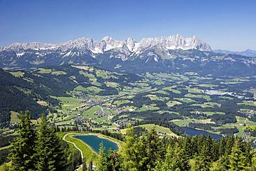 View from the Hahnenkamm summit onto impounding reservoir and Lake Schwarzsee, near Kitzbuehel, behind Wilder Kaiser, Kaiser Mountains, Alps, Tyrol, Austria, Europe