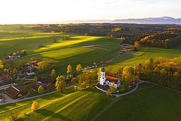 Holzhausen with St. Johann Baptist church in the morning light, Holzhausen near Muensing, Fuenfseenland, Upper Bavaria, Bavaria, Germany, Europe