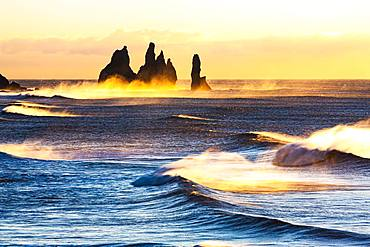 Reynisdrangar, stormy sea at sunrise, near Reynisfjara, Sudurland, South Iceland, Iceland, Europe