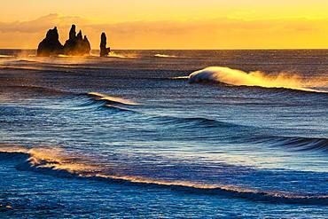 Reynisdrangar, stormy sea at sunrise, near Reynisfjara, Sudurland, South Iceland, Iceland, Europe