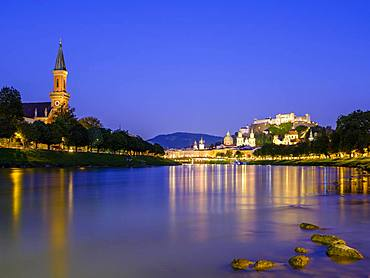 City view, old town and fortress Hohensalzburg over the river Salzach at dusk, Salzburg, Land Salzburg, Austria, Europe