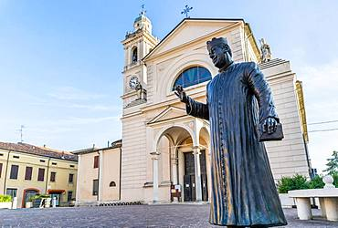 Statue of Don Camillo in Piazza Giacomo Matteotti in front of the Church of Santa Maria Nascente, location of the films of Don Camillo and Peppone, Brescello, Province of Reggio Emilia, Emilia-Romagna, Italy, Europe
