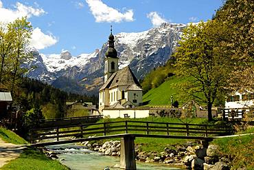 Parish church St. Sebastian in spring with Ramsauer Ache, Reiteralpe at the back, Ramsau, Berchtesgaden, Berchtesgadener Land, Upper Bavaria, Bavaria, Germany, Europe
