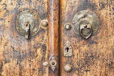 Old wooden door with door knockers, Abyaneh village, Esfahan Province, Iran, Asia