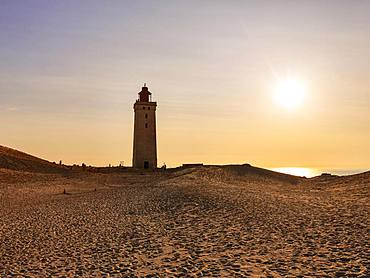 Lighthouse on the moving dune Rubjerg Knude at sunset, Lokken, Lokken, Nordjylland, Nordjutland, Denmark, Europe