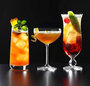 Three different fruity cocktails, black background, Germany, Europe
