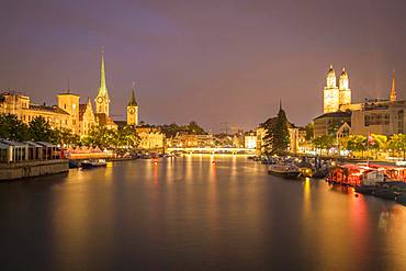 View over river Limmat at dusk, old town with Fraumuenster, St. Peter and Grossmuenster, old town, Zurich, Switzerland, Europe