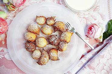 Swabian dessert, Nonnenfuerzle, fat baked with vanilla sauce, lard biscuits, plate, cake fork, roses, Germany, Europe