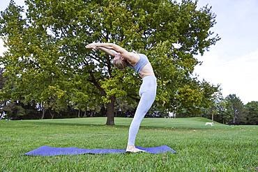 Young woman doing yoga in the park, gymnastics, Olympiapark, Munich, Germany, Europe