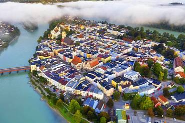 Old town in river loop of the Inn at sunrise, moated castle am Inn, aerial view, Upper Bavaria, Bavaria, Germany, Europe
