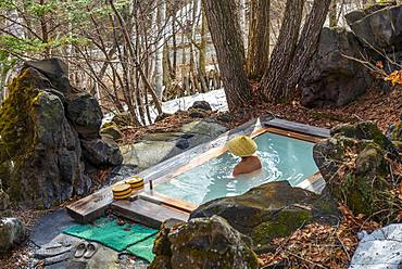 Woman bathing in an onsen, hot thermal spring of a guesthouse, Matsumoto, Japan, Asia