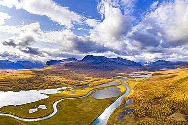 Autumn landscape with river, lakes and mountains, river Visttasjohka, Nikkaluokta, Lapland, Sweden, Europe