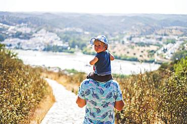 Father walking with his son, Spain, Europe