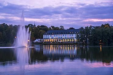 Lake Burgsee, Burgseeklinik hospital and the Old Town at dusk, Bad Salzungen, Thuringia, Germany, Europe