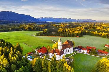 Wieskirche in the morning light, pilgrimage church to the Scourged Saviour on the Wies, Wies, near Steingaden, Pfaffenwinkel, aerial view, Upper Bavaria, Bavaria, Germany, Europe