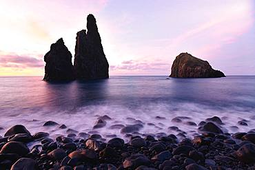 Volcanic rock formation Ilheus da Rib, steep coast of Ribeira de Janela, also Ribeira da Janela, sunset, Porto Moniz, island Madeira, Portugal, Europe