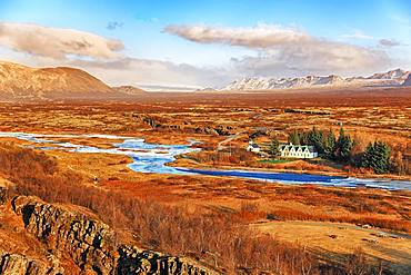 Pingvellir, Thingvellir National Park, church and five-gable house by the river, sunny autumn day, Golden Circle, Iceland, Europe