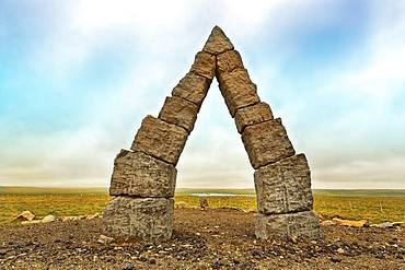 Monumental stone gate in barren landscape, Arctic Henge, Raufarhoefn, Melrakkasletta, Northeast Iceland, Iceland, Europe