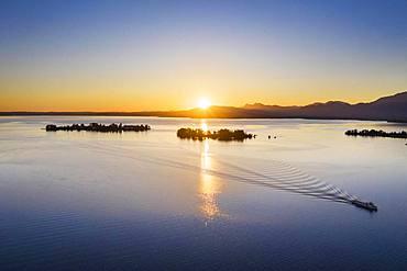 Sunrise, Chiemsee with islands Fraueninsel and Krautinsel, Chiemgau, aerial view, Upper Bavaria, Bavaria, Germany, Europe