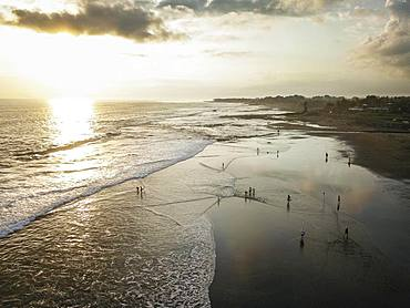 Aerial view, Black volcanic beach with waves running out in the sunset, walker, Canggu Beach, Bali, Indonesia, Asia