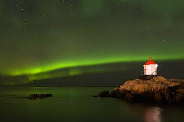 Northern Lights via lighthouse (Aurora borealis), Eggum, Vestvagoy, Lofoten, Norway, Europe