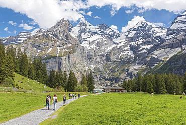 Hiking trail to the Restaurant Zur Sennhuette at the Oeschinensee, behind Blueemlisalp, Kandersteg, Bernese Oberland, Canton of Bern, Switzerland, Europe