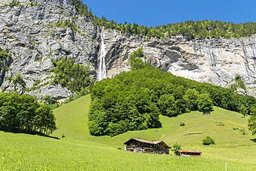 Rock face with Staubbach Falls, Lauterbrunnen Valley, Lauterbrunnen, Bernese Oberland, Switzerland, Europe