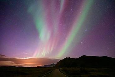 Northern Lights over mountain landscape (Aurora borealis), Lofoten, Norway, Europe