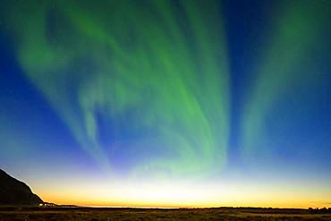 Northern Lights (Aurora borealis) at sunset, Lofoten, Norway, Europe