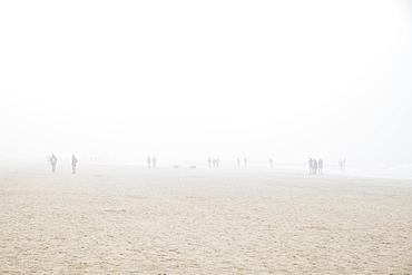 Beach with people in fog, Egmond aan Zee, Netherlands